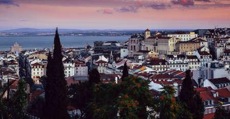 Lisbon, Portugal magenta sunset overlooking Baixa neighbourhood with major landmarks visible