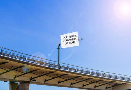 Positivity happiness ahead message written at highway overpass billboard Banco de Imagens