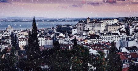 Lisbon, Portugal winter snowy scene overlooking Baixa neighbourhood with major landmarks visible