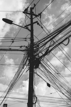 Tangle of Electrical Wires on Power Pole 版權商用圖片