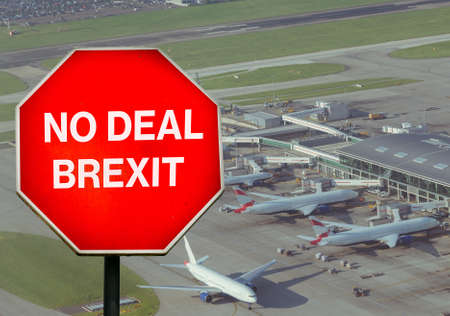 No Deal Brexit digital composite sign with high perspective view of airport terminal in background Stock Photo