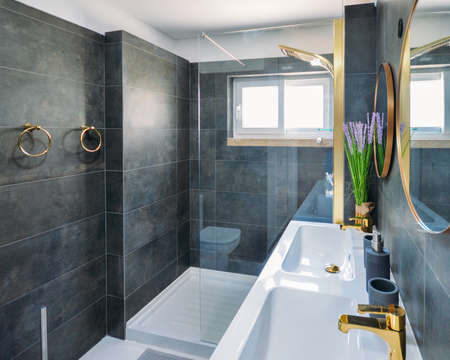 Modern stylish bathroom in upscale residential home 写真素材 - 129721233