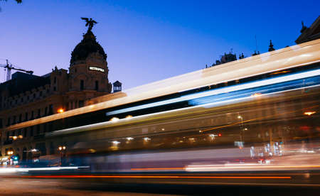 Madrid, Spain long exposure light streaks from moving vehicles at Calle de Alcala and Gran Via Фото со стока