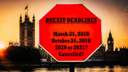 Brexit deadlines past and future written on stop-sign with Houses of Parliament, London in background.