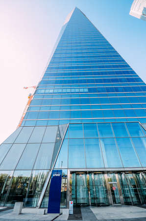 KPMG glass tower at Cuatro Torres business area - finance district in Madrid, Spain