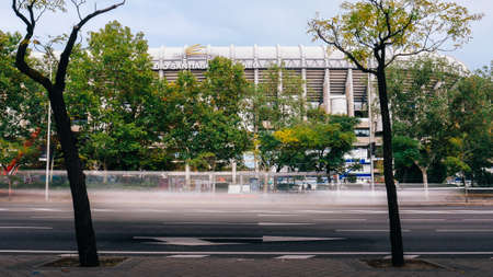 Long exposure of cars rushing past a street in front of Santiago Bernabeu Stadium of Real Madrid in Madrid, Spain