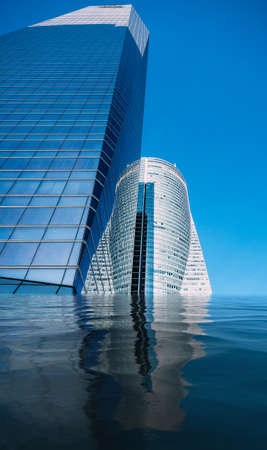 Flooded business skyscrapers on the blue sky - climate change concept.