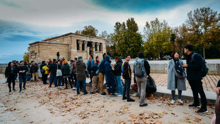 Tourists queue to enter the Temple of Debod, an ancient Egyptian temple which was rebuilt in Madrid, Spain