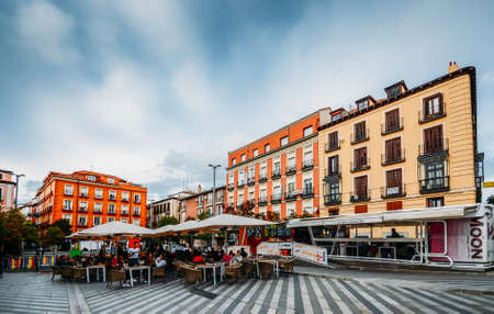 People relax for drinks and a chat at Plaza Sta. Maria Soledad Torres Acosta in Madrid, Spain Editöryel