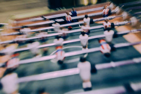 Table football or soccer game, also known as Foosball, with zoom blur effect