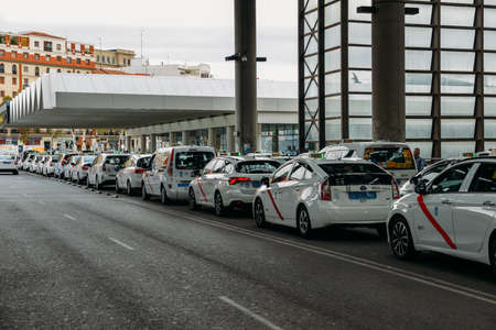 Row of white taxis in front of Atocha train station in Madrid, Spain