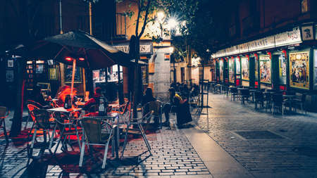 Tapas bar in Madrid, Spain with traditional tiles. People sitting at terrace enjoying an evening Editöryel