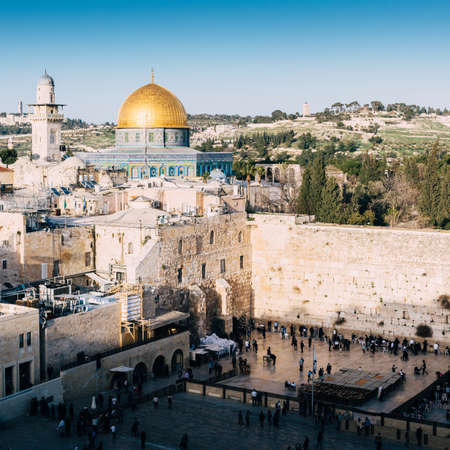 The Western Wall is the remnant of the ancient wall that surrounded the Jewish Temples courtyard in jerusalem, Israel. Dome of the Rock is a Muslim Shrine located on the Temple Mount Фото со стока