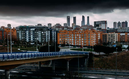 View of Sanchinarro neighbourhood looking towards the Cuatro Torres Business district in Madrid, Spain. Фото со стока