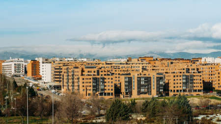 View of residential neighbourhood in Las Tablas, Madrid, Spain with mountain range in background