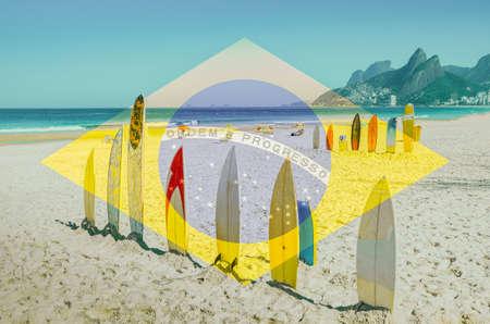 Row of surfboards at Ipanema beach, Rio de Janeiro. Brazilian flag a digital manipulation composite 스톡 콘텐츠