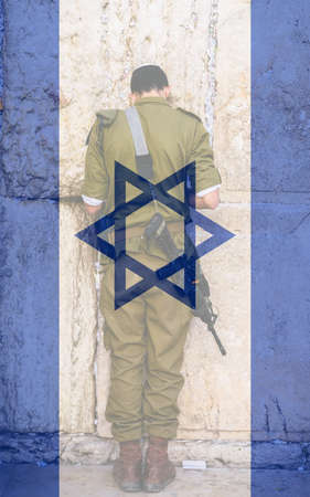 An Israeli Defence Force soldier prays at the Western Wailing Wall in Jerusalem, Israel