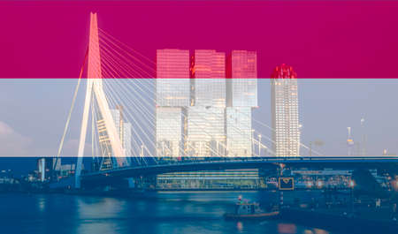 Erasmus bridge on Meuse river, Rotterdam at night superimposed with a Dutch flag. Фото со стока
