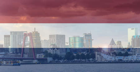 Panorama of Rotterdam city centre over Nieuwe Maas river, Netherlands superimposed with a Dutch flag Фото со стока