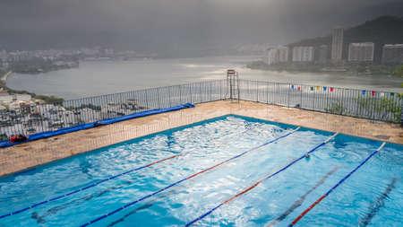 Empty swimming pool overlooking Lagoa Rodrigo de Freitas in Rio de Janeiro, Brazil 스톡 콘텐츠