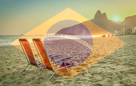 Beach deck chair against a backdrop of Two Brothers Mountain in Rio de Janeiro, Brazil