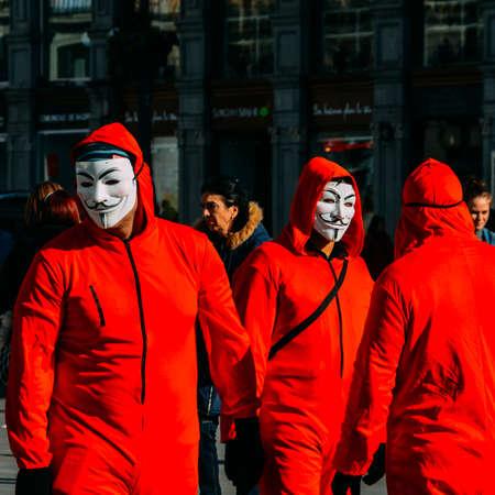 Masked member of Anonymous in Puerta del Sol, Madrid, Spain Editorial