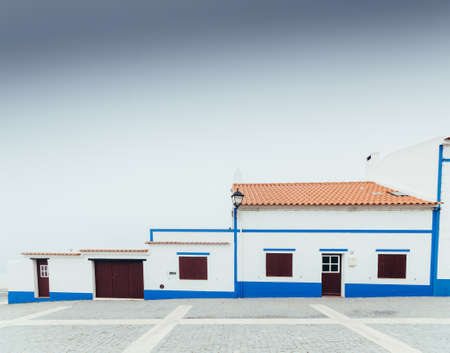 Traditional house facade in Porto Covo, Alentejo, Portugal