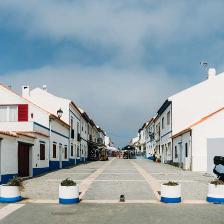 Main street in pictureque Porto Covo in Portugal Stock fotó