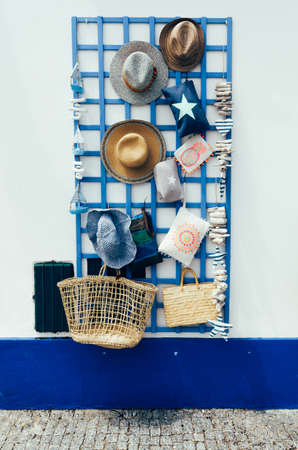 Souvenirs on display on a wall in Porto Covo, Alentejo, Portugal