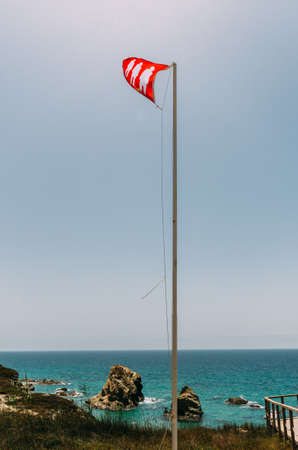 Flag on beach indicating that the beach is crowded during times of COVID-19 epidemic