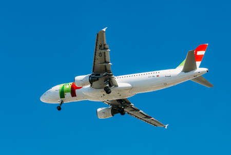 Passenger aircraft Airbus A320 of TAP Portugal Airlines in flight. Blue sky in the background. Sajtókép