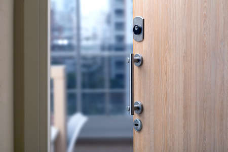 Open door of a family home. Close-up of the lock in an armored door in a department.