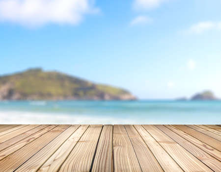 Wooden platform with blurred background of sea and hills. Deck ready for put product in display. Stage for objects presentation with copy space.
