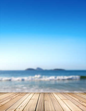Empty stage for products. Blurred sea background with wood resort deck floor in foreground. Image of Ipanema beach in Rio de Janeiro, Brazil. Zdjęcie Seryjne