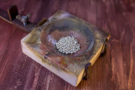 crucible: silver granules in crucible Stock Photo
