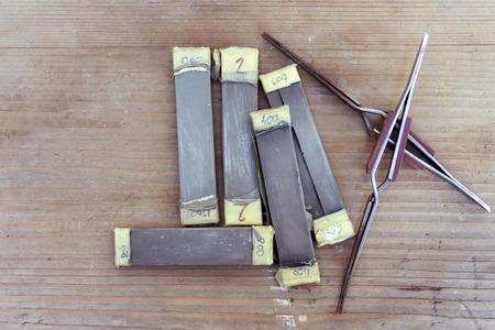 Different grit sanding sticks on a jewller