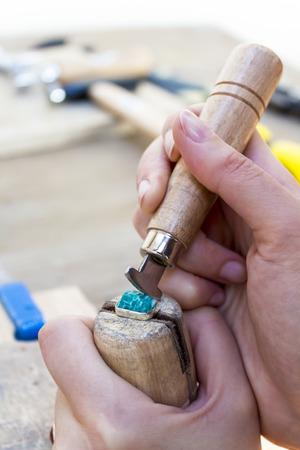 amazonite: Stonesetting a rough amazonite using a ring clamp Stock Photo