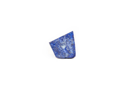 lapis: Rough Lapis Lazuli gemstone on a white background