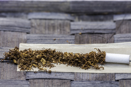 rolling paper: Tobacco in rolling paper with a slim filter