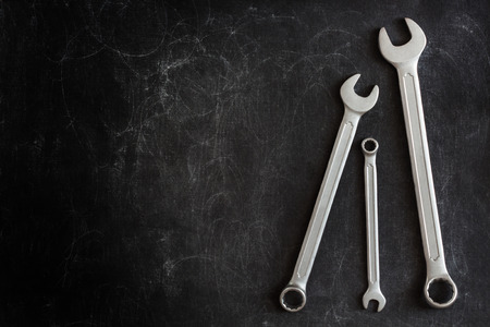 manly: Set of 3 Wrenches on a Dark Textured Background