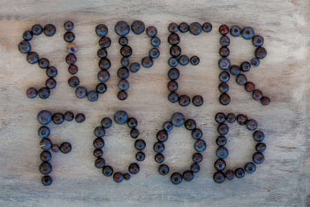 Super Food text written with Blueberries