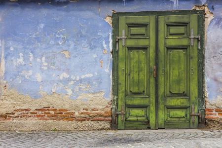 green door: Blue wall and green door