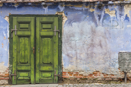 Blue wall and green door