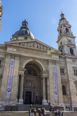 neo classical: Budapest, Hungary - March 14, 2016: Tourists in front of St. Stephens Basilica in Budapest, Hungary Editorial