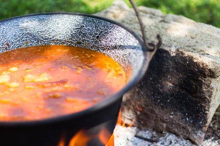 Gulyas stew boiling in a cauldron