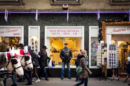 Vienna, Austria - December 17, 2016: People walking in front of a gift shop in Vienna, Austria