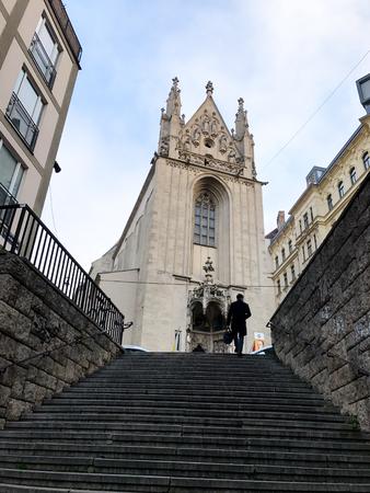 Vienna, Austria - December 17, 2016: Man walking towards the Maria am Gestade church in Vienna, Austria