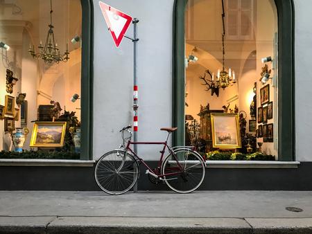 Vienna, Austria - December 17, 2016: Bicycle parked in front of an art shop in Vienna, Austria