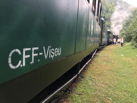 Viseu de Sus, Romania - August 6, 2017: Mocanita steam train going into the mountains of Maramures
