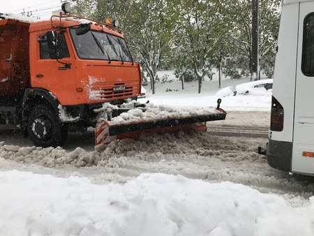 Chisinau, Moldova - April 21, 2017: Kamaz snowplow on the street of Chisinau after a heavy snowfall 新聞圖片